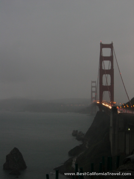 San Francisco, California - The Golden Gate bridge seen from the bay vista point on a rainy evening.